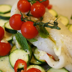 Fresh Cod in a Paper Bag with Zucchini, Tomatoes, and Mint