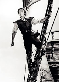Errol Flynn as The Seahawk high in the rigging of his ship