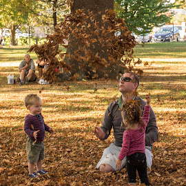 Autumn fun by Vibeke Friis - People Family ( dad, children throwing autumn leaves, girl, boy, man, , fall, color, colorful, nature )