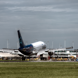 Touchdown 1 by Mike Bing - Transportation Airplanes ( schiphol, landing, runway, touchdown, air transat, amsterdam, netherlands )
