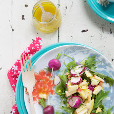 Radish salad with apple, avocado, egg and shaved Manchego