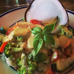 Gluten Free Coconut Curry Chicken with basmati and jasmin rice, grilled vegetables and a coconut.