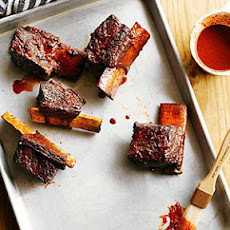 Achiote Short Ribs with Ancho Barbecue Sauce and Avocado Relish