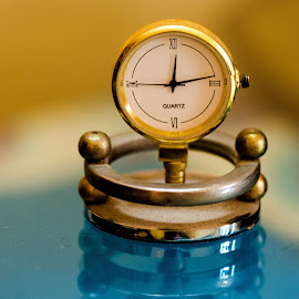 Still,make you move by Sanjeev Goyal - Artistic Objects Still Life ( toy, clock, blue, yellow, golden, object )