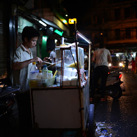 Street Food Vendor in Hanoi by Kaarel Antonov - Food & Drink Cooking & Baking ( streetphotography, latenight, vendor, street, candid, vietnam, travel, liights, midnight, food, hanoi, cooking, night, light )