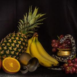 A Snake amongst the fruit by Massimo Crisafi - Food & Drink Fruits & Vegetables ( studio, snake, low key, still life, fruits, low light )