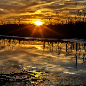 Fire and Ice by Lynda Blair - Landscapes Sunsets & Sunrises ( clouds, sunset, ice, trees, river,  )