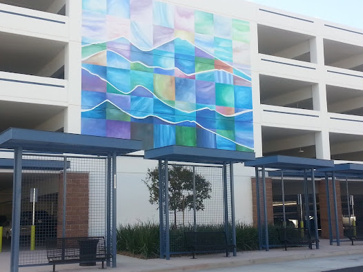 Daly's second north-facing mural serves as a companion to her first mural on the parking structure's opposite south-facing side.