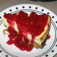 Luscious Lemon Cheesecake With Raspberry Sauce