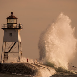 Lighthouse Storm by David Johnson - Buildings & Architecture Other Exteriors ( grand marais, waves, lighthouse, lake superior, seascape )