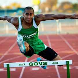 High Stepping by Bob Grandpre - Sports & Fitness Running ( hurdles, track & field, track, running, jump )