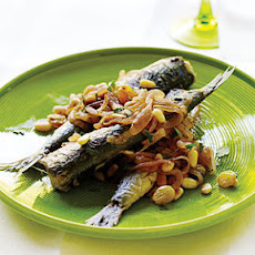 Pan-Fried Sardines with Sweet-and-Sour Onions, Pine Nuts, and Raisins