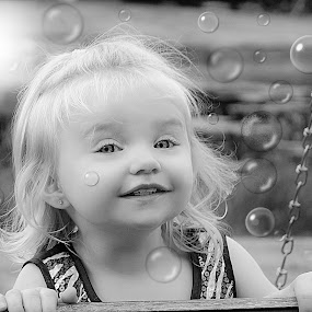 Bubble Machine Fun B & W by Cheryl Korotky - Black & White Portraits & People ( expression, child model peyton, a heartbeat in time photography, children playing, bubbles, b & w, portrait, pose, cute baby pictures, wedding, amazing faces, beautiful children, fun pictures,  )