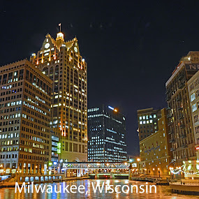 Downtown Milwaukee on the river by Jason Lockhart - Typography Captioned Photos ( milwaukee, wisconsin, cold, tall buildings, ice, night, frozen, downtown, river )