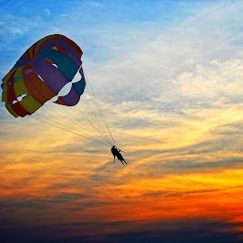 Flying in the Sky by Prosenjit Ghosh - Sports & Fitness Watersports ( flying, games, color, water sports, sunset, parasuit, colva, goa, india, beach, people )