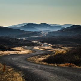 Curves by Hallgrimur Helgason - Landscapes Mountains & Hills ( mountains, blue, fall, road, curves, mist, path, nature, landscape )