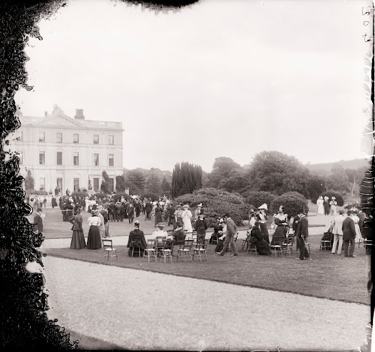 The formal Curraghmore gardens, overlooking a man-made lake, made a perfect setting for a  garden party. (Poole IMP 402).