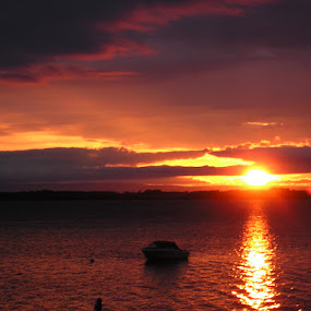 Sunset over the Adirondacks by Raymond Paul - Landscapes Sunsets & Sunrises ( clouds, mountains, sunset, lake, boat )