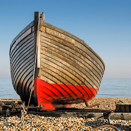 Golden Spray by Darrell Evans - Transportation Boats ( seafront, wood, ship, rowing boat, secure, pebbles, ocean, seaside, beach, coastline, coast, weathered, attractive, sunny, pier, shingle, ships, water, waves, boats, stern, sea, leisure, boat, row, holiday, red, wooden, blue, peace, outdoor, rudder, keel )