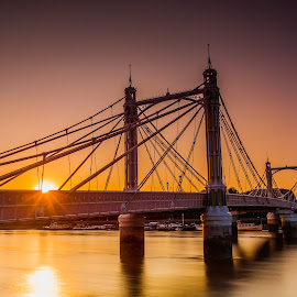 Sun Behind The Bridge by Naf Selmani - Buildings & Architecture Bridges & Suspended Structures ( europe, londra, ロンドン, লন্ডন, cityoflondon, travel, londres, 伦敦, england, londýn, לונדון, لندن, lontoo, лондон, nikon, albertbridge, λονδίνο, uk, londen, london, londyn, sunset, 런던, लंदन, summer, longexposure, riverthames, iandthecamera )