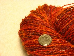 Orange skein closeup with dime