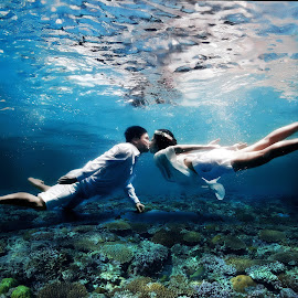 Love Beyond the Sea by Suban Edyono - Wedding Bride & Groom ( coral, seashore, kissing, underwater, nikond7000, nikonian, love, kiss, corals, underwaterwedding, prewedding, seacorals, iamnikon, tyingknot, wedding, brideandgroom, bride, nikon, groom )
