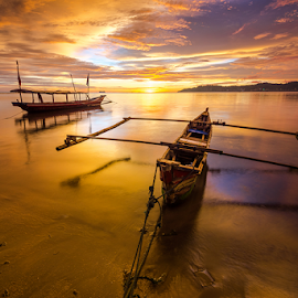 Nirwana Beach at Dusk by Ade Noverzan - Transportation Boats ( sunset, twilight, boats, beach, dusk )