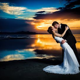 Sunset Romance by David Terry - Wedding Bride & Groom ( water, love, reflection, colorful, wedding, colors, sunset, romantic, lake, couple, bride and groom, romance )