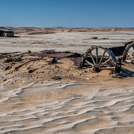 A Bygone Era by Johan Jooste Snr - Transportation Other ( sand, namib desert, desert, hut, wheels, ox-wagon, namibia )