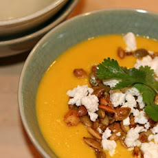 Cream of Carrot Soup with Fire-Roasted Chiles, Toasted Pepitos and Crumbled Feta