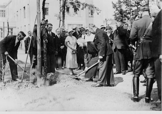 Marie Curie planting a tree at the Radium Institute of Warsaw, May 29th 1932