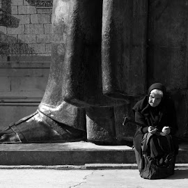 Old woman and a statue by Petar  Botteri - City,  Street & Park  Street Scenes ( split )