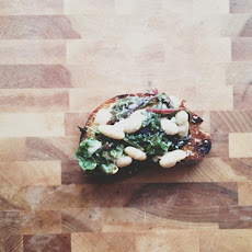 Crostini with Braised Beans, Baby Chard, and Anchovies