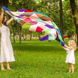 our blanky by Adrian Podaru - People Family ( playing, girl, mother, park, mommy, family )