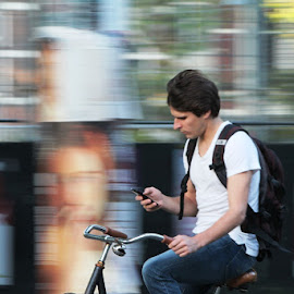 by Poornima Raju - Transportation Bicycles ( texting, phone, bike, man )