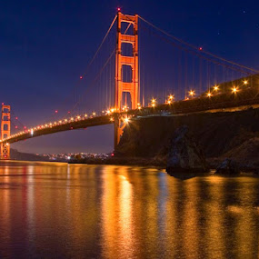 Golden Gate Bridge at dusk with reflections. by Gale Perry - Buildings & Architecture Bridges & Suspended Structures ( blue, orange. color, , #GARYFONGDRAMATICLIGHT, #WTFBOBDAVIS )