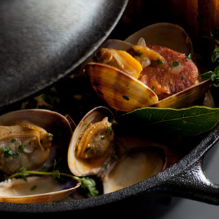 Steamed Manila Clams with Tomato, Vermouth, Linguica Sausage and Toasted Focaccia