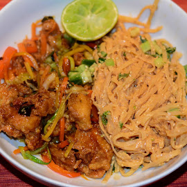crispy orange chicken and stir fried veggies with sesame peanut noodlesspent 2 hours in the kitchen but it was yummy by Nicky Semenza - Food & Drink Plated Food