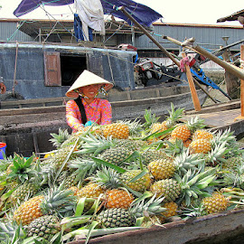 Nothing but pineapples by Leong Jeam Wong - Food & Drink Fruits & Vegetables ( water, fruit, market, ferry, transport, food, delta, mekong, boat, river )