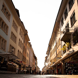 Switzerland - Winterthur by Ken Susi - City,  Street & Park  Street Scenes ( famous, destinations, reflection, zurich, europe, arch, church, twilight, street, travel, limmat, dusk, capital, tower, sunset, switzerland, cathedral, bridge, downtown, river )