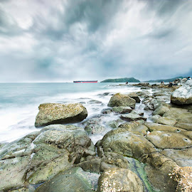 Sandwiched Between Sky and Water by Anna Varona - Landscapes Beaches ( water, clouds, sisiman, sky, ship, asia, storm, bataan, longexposure, philippines, rocks, brewing )