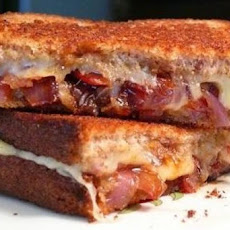 Grilled Sausage Sandwiches with Caramelized Onions and Gruyère Cheese