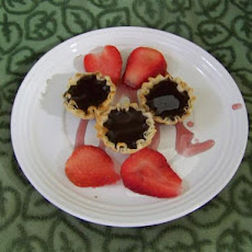 Warm Chocolate Tart With Red Wine Sauce