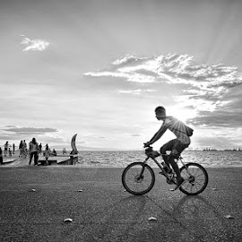 Biker by George Petridis - City,  Street & Park  Street Scenes ( black and white, sunset, biker, street, dock )