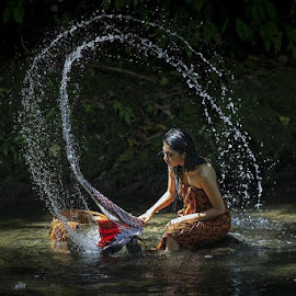 by Mohana Chandran Nair - People Street & Candids ( water, girl, splash, laundry )