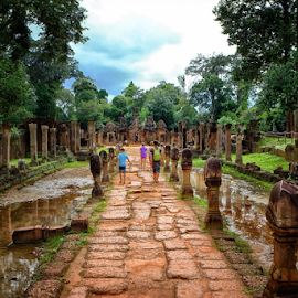 Tourist Exiting by Ferdinand Ludo - City,  Street & Park  Historic Districts ( tourist, banteay srei, cambodia )