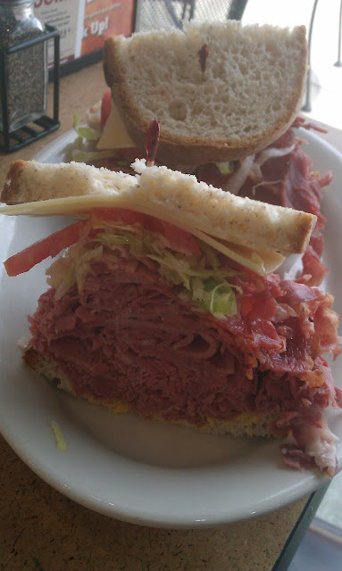 The New York Yankee 3/4 lb combo of hot corned beef and pastrami swiss mustard, and mayo on gf bread