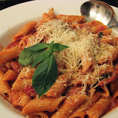 Pasta in Sausage, Cremini, and Tomato Cream Sauce
