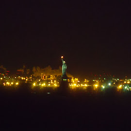 Lady Liberty at Night by Lindsay Jones - City,  Street & Park  Skylines ( statue of liberty, distant, night )