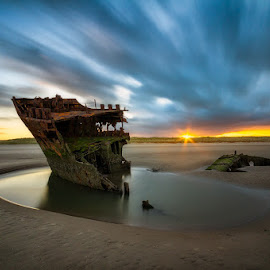 Baltray by Rafal Rozalski - Landscapes Beaches ( clouds, ireland, shipwreck, wreck, sunset, long exposure, beach, landscape, baltray, sun, rrphoto, rozalski )